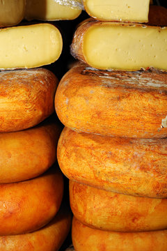 Piles of Mahon Menorca Minorca cheese made with cow's milk