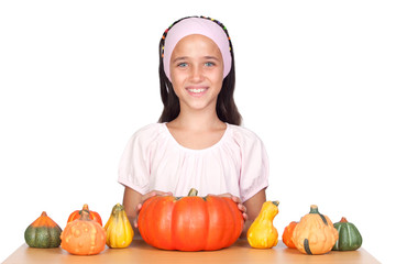 Wall Mural - Happy girl in Halloween with a many pumpkins