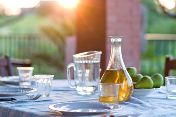 table setting with white wine and fresh figs outside