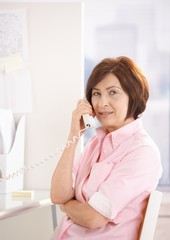 Portrait of mature office worker on phone call