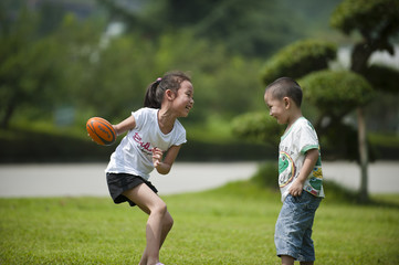boy and girl  play ball