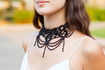 beautiful adornment on neck of young woman