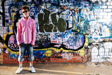 Young Teenager against graffiti wall.