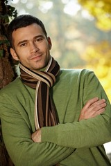 Portrait of handsome young man in autumn park