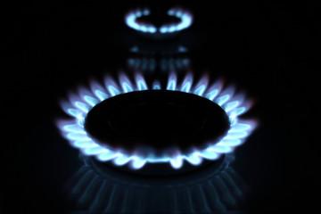 Close up of kitchen gas range with burning..
