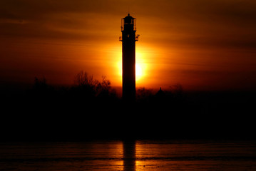 lighthouse at the sunset