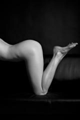 Naked woman on black background