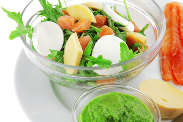 salad with salmon in transparent bowl