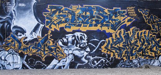 Graffiti on wall in back alley