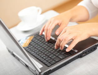 Woman's hands and laptop