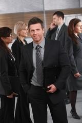 Businessman on office corridor