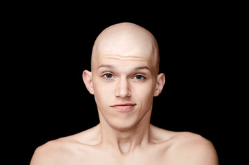 bald man isolated on a black