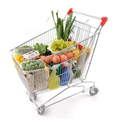 Shopping trolley full of grocery isolated on white background.