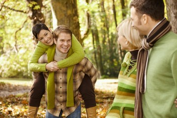 Two couples having fun in autumn park