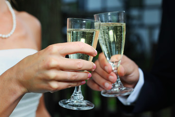 Bride & groom toasting with champagne sparkling wine