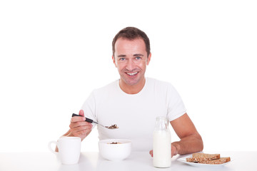 handsome man taking breakfast