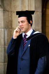A portrait of a young European man in a graduation gown.
