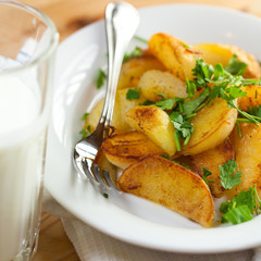 Roasted potatoes with herbs and a glass of buttermilk