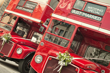 Door stickers London red bus Double Decker buses with just married sign in London.
