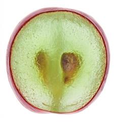 Translucent slice of red grape fruit, macro isolated on white