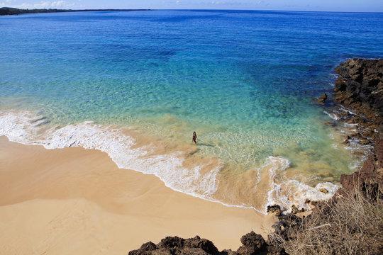 young woman at makena beach in maui, hawaii