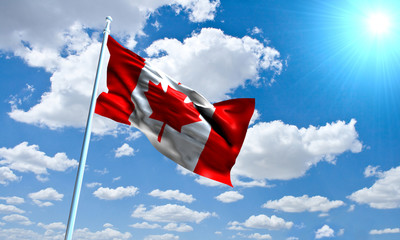 Canadian Flag in front of vivid, sunny, cloudy sky