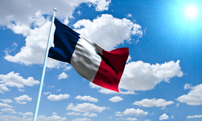 French Flag in front of vivid, sunny, cloudy sky
