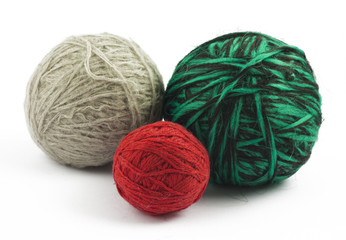Three balls of wool on white background