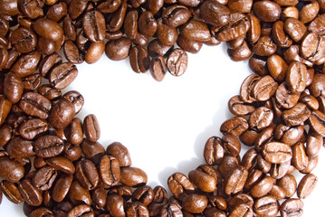 Background heart of coffee grains