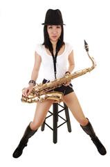 A saxophonist sitting.