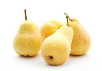 four yellow pears with water drops