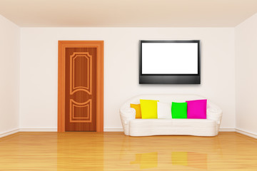 living room with door and white couch and LCD tv
