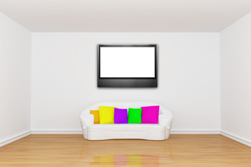 room with white couch and LCD tv