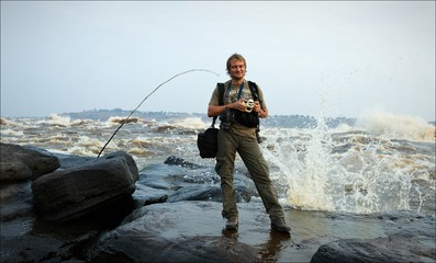 The photographer costs on the bank of raging river Congo.