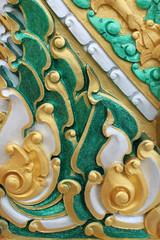 Thai art carving on wall of temple, Wat Ra Han, Buriram