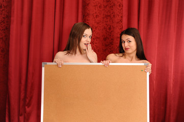 two girls hold blank board