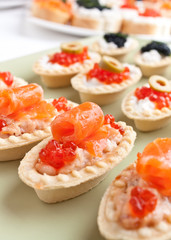 large group of canape with salmon and caviar