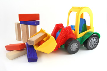 Plastic toy, excavator and wooden blocks