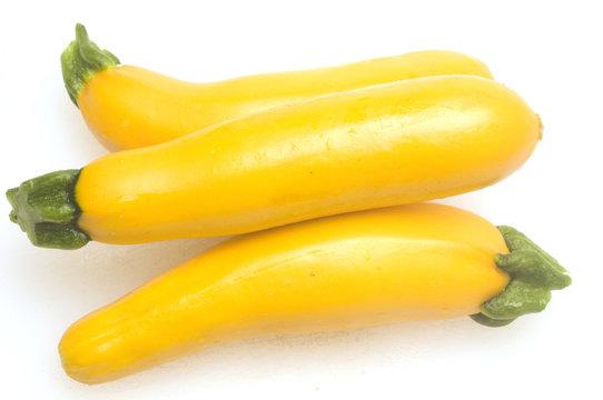 three yellow zucchini squash