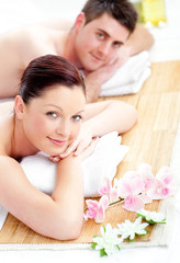 Caucasian young couple lying on a massage table