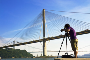 man take photo of the bridge