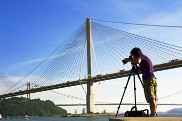 man take photo of the bridge