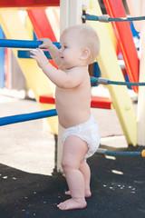 littele baby play on playground