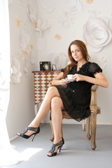 attractive girl with a cup of cofee