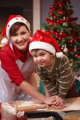 Mum and son having fun at christmas baking