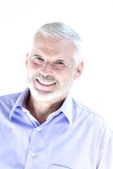 Senior man portrait toothy smile