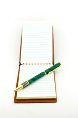 notepad with pen isolated on white