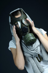 girl covering face with protection equipment