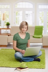 Young woman teleworking with computer