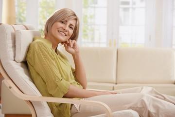 Portrait of woman in armchair